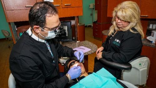 dr. al, staff & patient working